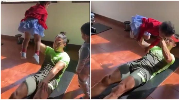 Working out from home Cristiano Ronaldo uses his kids as WEIGHTS during coronavirus lockdown exercise session VIDEO