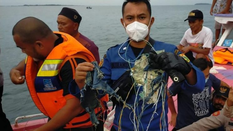 Searchers find debris during operation to locate missing